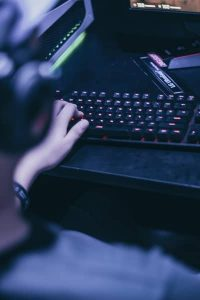 Gamer Holding a Red Keyboard